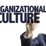 Business man pointing the text: Organizational Culture